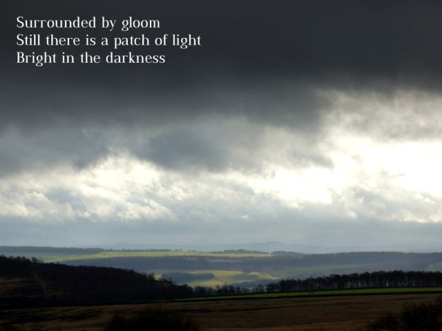surrounded-by-gloom-still-there-is-a-patch-of-light-bright-in-the-darkness
