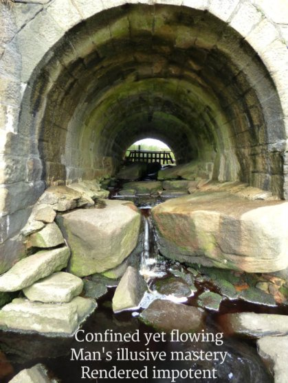 image of stream in culvert - confined-yet-flowing-mans-illusive-mastery-rendered-impotent